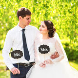 Funny bride and groom with Mr and Mrs signs. Happy wedding day Royalty Free Stock Images