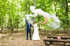 Funny bride and groom outdoors. Happy wedding day Royalty Free Stock Photography