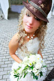 Funny bride in hat Royalty Free Stock Photo