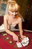 Funny bride playing cards Royalty Free Stock Photography