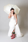 Funny bride with umbrella royalty free stock images