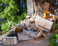 Funny broken furnitures trash pile Stock Photo