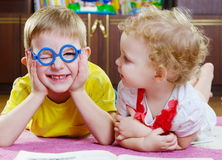 Funny brother in glasses with sister Stock Images