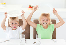 Funny brother and sister asking for their lunch Stock Photography