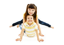 Funny brother and sister lying on the floor Royalty Free Stock Image