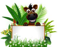 Funny brown horse with blank sign Royalty Free Stock Photography