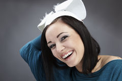 Funny Brunette in a bright sweater with rabbit ear Royalty Free Stock Photo