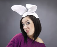 Funny Brunette in a bright sweater with rabbit ear Stock Photos