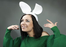 Funny Brunette in a bright sweater with rabbit ear Stock Images