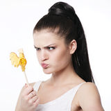 Funny brunette with rooster Lollipop Stock Photo