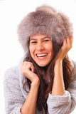 Funny brunette woman in a fur hat Stock Photography