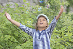 Funny bubbles. Boy is happy in the summer of soap bubbles Stock Images