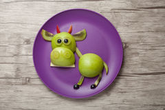 Funny bull made of fresh vegetables Royalty Free Stock Photography