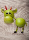 Funny bull made of green apple and kiwi Royalty Free Stock Photo