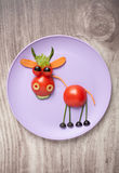 Funny bull made of vegetables on plate Royalty Free Stock Photos