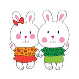 Funny bunnies holding hands. Stock Image
