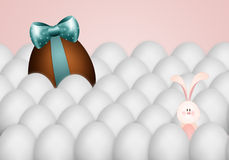 Funny bunny with chocolate egg Stock Photography