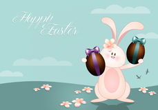 Funny bunny with chocolate eggs Stock Photography
