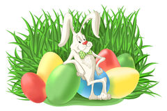 Funny bunny rabbit with colorful Easter eggs Stock Images