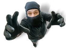 Funny burglar is stretching towards camera filming him from top Royalty Free Stock Photo