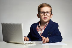 Funny business child with computer stock photos