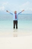 Funny business man on the beach Royalty Free Stock Photo