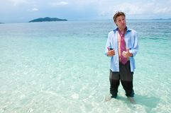 Funny business man on the beach Royalty Free Stock Photography