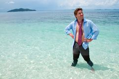 Funny business man on the beach Royalty Free Stock Image