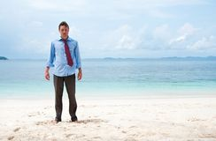 Funny business man on the beach Royalty Free Stock Photos