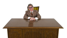 Funny Business Man or Boss, Big Smile Isolated. Funny businessman sits at office his desk and has a big smile on his face. He must love his job! The silly suit Royalty Free Stock Photo