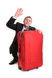 Funny business man hide behind red luggage Stock Images