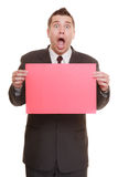 Funny business man holding sign red blank Royalty Free Stock Image