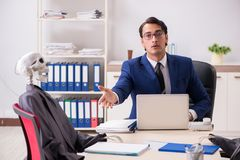 The funny business meeting with boss and skeletons royalty free stock photography