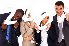 Funny business people. Group of funny business people holding numbers stock images