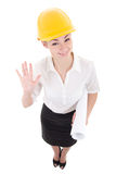 Funny business woman architect in yellow builder helmet showing Royalty Free Stock Photo