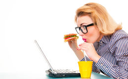 Funny business woman holding sandwich Royalty Free Stock Image