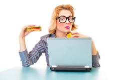 Funny business woman holding sandwich. And drinking juice, isolatd on white. Studio shot Stock Photos