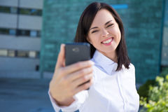 Funny business woman making selfie photo on smartphone Stock Photo