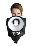 Funny business woman shouting with a megaphone Royalty Free Stock Image