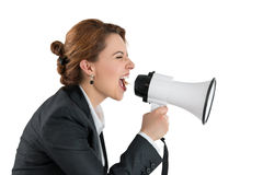 Funny business woman shouting with a megaphone Royalty Free Stock Photos
