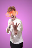 Funny business woman singing with big orange eyeglasses Stock Photography