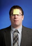 Funny businessman. With yellow sticky note on forehead Royalty Free Stock Image
