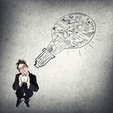 Funny businessman with alarm clock. Young businessman holding old alarm clock on sketch background Royalty Free Stock Photo