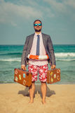 Funny businessman on the beach. Portrait of funny businessman on the beach. Man having fun by the sea. Summer vacation and travel concept Royalty Free Stock Photos