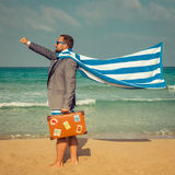 Funny businessman on the beach. Portrait of funny businessman on the beach. Man having fun by the sea. Summer vacation and travel concept Stock Image