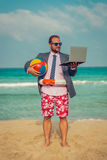 Funny businessman on the beach Royalty Free Stock Photos