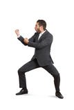Funny businessman beating his fist Royalty Free Stock Photos