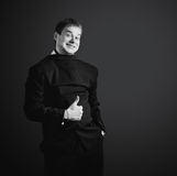 Funny businessman in black suit, dressed Royalty Free Stock Image