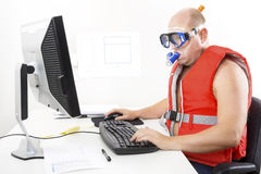 Funny businessman in diving mask and snorkel. Strange office worker in life vest and scuba diver gear at the office. Combines vacation and work Stock Photo
