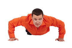 Funny businessman doing push-ups Stock Images